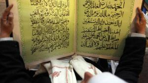 A man reads the Koran in a mosque in Sanaa (photo: Reuters)