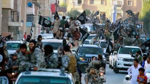 IS supporters after the city of Raqqa in Syria fell to Islamic State (photo: picture-alliance/AP Photo)