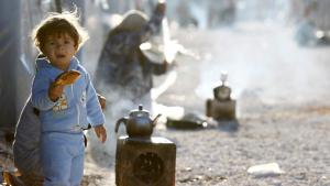 A Kurdish refugee child from the Syrian town of Kobani in a refugee camp in Suruc, Turkey, 20 October 2014 (photo: Reuters/Kai Pfaffenbach)