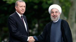 Iran's President Hassan Rouhani (right) is welcomed by Turkey's Prime Minister Recep Tayyip Erdogan as he arrives for a meeting in Ankara on 9 June 2014 (photo: Reuters)