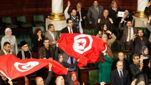 Members of the Tunisian parliament after the passing of the country's new consitution on 26 January 2014 (photo: Reuters)