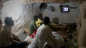 Syrians watching the news in a cellar (photo: Getty Images)