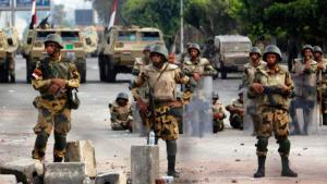 Egyptian soldiers standing at an army roadblock in Cairo (photo: Reuters)