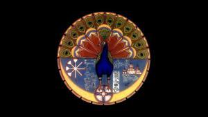 The blue peacock, symbol of the Yazidi faith (source: Wikipedia)