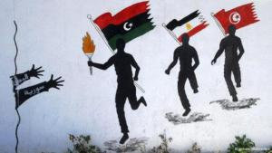 In this mural, three runners hold up the flags of Libya, Egypt and Tunisia respectively, bringing the flame of freedom to their brothers in Syria and Yemen (photo: picture-alliance/dpa)