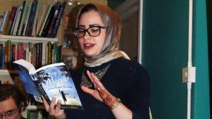 Sumia Sukkar reads from her novel at a launch in an Oxfam shop (photo: Susannah Tarbush)
