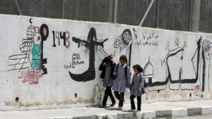 Palestinian schoolgirls from Hebron on their way to school (photo: HAZEM BADER/AFP/Getty Images)