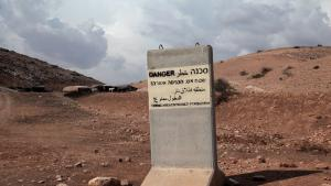 The army has declared the area a military training ground and says it is too dangerous for the residents to remain because of constant gunfire. Pictured here: an Israeli military sign placed on Bedouin-inhabited land forbidding all non-military personnel from entering the area because it has been declared a military firing area.