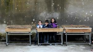 Syrian children in a schoolroom riddled with bullet holes, Aleppo (photo: Reuters/Muzaffar Salman)