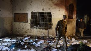 A Pakistani soldier walks through the Army Public School a day after the deadly attack by Taliban militants in Peshawar, 17 December 2014 (photo: AFP/Getty Images/A Majeed)