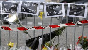 "Flowers and signs that read (from left) ""I am Charlie"", ""I am a police officer"", ""I am in mourning"" and ""I am Jewish"" are seen near a kosher grocery store in Paris, 10 January 2015 (photo: AFP/Getty Images/K. Tribouillard)"
