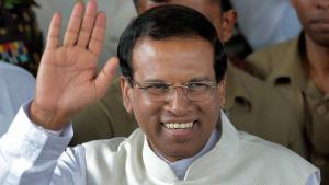 Sri Lankan President Maithripala Sirisena waves to supporters as he leaves the election secretariat in Colombo, Sri Lanka, 9 January 2015 (photo: picture-alliance/AP/Eranga Jayawardena)