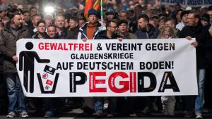 """It all began in Dresden on 20 October 2014. Organised by a hitherto unknown movement calling itself """"Pegida"""" (Patriotic Europeans Against the Islamisation of the West), a small group of people took to the streets to demonstrate against what they saw as the Islamisation of the West. The banner reads """"non violent and united against religious wars on German soil! PEGIDA"""". Although small, the march attracted a lot of attention in Germany and around the world."""