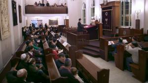 Congregants of Kreuzberg's Fraenkelufer Synagogue gather in December 2014 to celebrate the first night of Chanukah (photo: William Noah Glucroft)