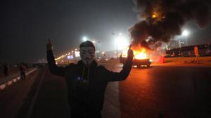 A masked man during the football riots in Cairo, 8 February 2015 (photo: STR/AFP/Getty Images)