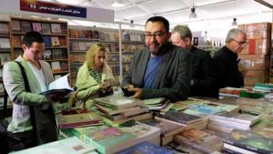 "Sherif Bakr, initiator of the ""Cairo Calling"" programme, during a tour of the 2015 Cairo International Book Fair (photo: Amira El Ahl)"