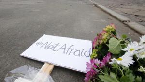 Flowers and a placard laid for the two men who were killed by an assassin in Copenhagen at the weekend (photo: AP)
