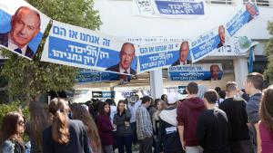 Israeli students at Blich high school walk past election posters for Israeli Prime Minister Benjamin Netanyahu during a mock polling day in the central city of Ramat Gan on 22 February 2015 (photo: Getty Images/MENAHEM KAHANA)