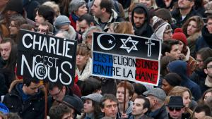 "People carrying placards reading ""We are Charlie"" and ""Religions united against hatred"" take part in a solidarity march in the streets of Paris on 11 January 2015 (photo: Reuters/Platiau)"