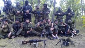 Ibragimkhalil Daudov (6th from right, front), leader of an Islamist rebel group in the North Caucasus, posing for a picture with other rebels in a forest in Dagestan (photo: REUTERS)