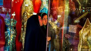 Forbidden fruit: two window shoppers wearing chadors gaze at sparkly dresses that don't leave much to the imagination. The morality police objected to the photo, which was not published in Iran.