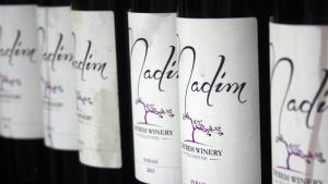 "Bottles of Taybeh's ""Nadim"" wine, Arabic for ""drinking buddy"" (photo: Ylenia Gostoli)"