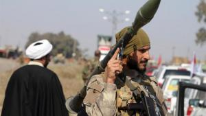 A Shia imam and a Shia fighter in Iraq (photo: Reuters)