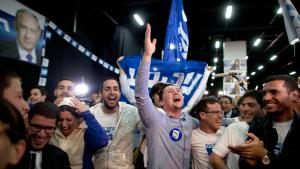Supporters of Israeli Prime Minister Benjamin Netanyahu celebrate as election results come in, Tel Aviv, 17 March 2015 (photo: Getty Images/L. Mizrahi)