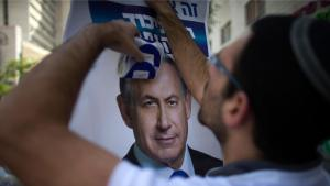 Likud campaign worker puts up a poster of Benjamin Netanyahu in Jerusalem (photo: Reuters/R. Zvulun)