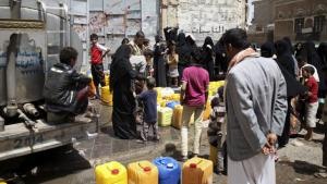 People filling containers with water from a water tanker in the Yemeni capital, Sanaa (photo: Reuters)