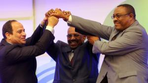 From left: Abdul Fattah al-Sisi, Omar al-Bashir and Hailemariam Desalegn join hands in a show of unity on 23 March 2015 (photo: Ashraf Shazly/AFP/Getty Images)