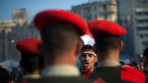 Soldiers and demonstrators face each other in Tahrir Square (photo: AP)
