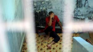A Free Syrian Army fighter in a prison in Aleppo (photo: picture-alliance/abaca)