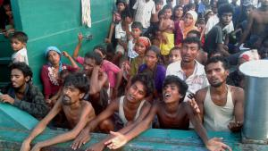 Rohingya migrants on a boat off the southern Thai island of Koh Lipe in the Andaman Sea. The boat, which was crammed with scores of Rohingya migrants, including many young children, was found drifting in Thai waters on 14 May. Passengers said several people had died in the previous days. Dozens of visibly weak people were on the deck of the stricken vessel, which was found apparently adrift several kilometres off Koh Lipe.