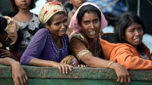 Rohingya migrant women cry on a boat drifting in Thai waters off the southern island of Koh Lipe in the Andaman Sea, 14 May 2015 (photo: Christophe Archambault/AFP/Getty Images)