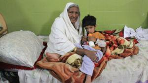 Jamila, an elderly Hindu from North Waziristan, and her grandson in a shelter in Bannu, Pakistan (photo: Kiran Nazish)