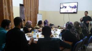Eric Maddox addressing a gathering of people taking part in a Virtual Iftar Project dinner (photo: Lora Lucero)