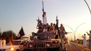 IS jihadists in Mosul in June 2014 (photo: picture-alliance/AP)