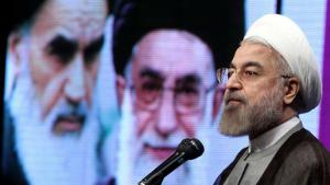President Hassan Rouhani giving a speech in Tehran in front of pictures of Ayatollah Ruhollah Khomeini and Ayatollah Ali Khamenei (photo: president.ir)