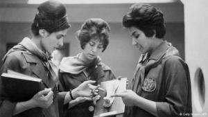 This picture, taken in 1962, shows two female medicine students at the University of Kabul listening to their professor as they examine a plaster model of a human body part. At that time, women played an active role in Afghan society. They also had access to education and were able to take up work outside home.