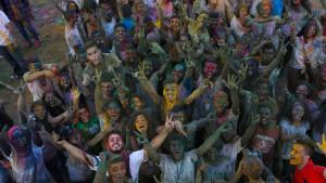 Young people celebrate the Holi-inspired Festival of Colour in Ramallah, 27 August 2015 (photo: Shadi Hatem)
