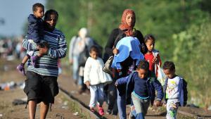 Syrian refugees at the Serbian-Hungarian border (photo: Getty Images/AFP/E. Barukcic)