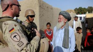 German soldiers in conversation with village dwellers near Kunduz in 2011 (photo: dpa/picture-alliance)