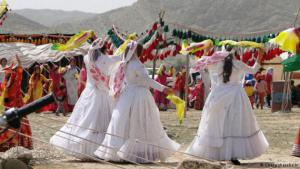 Three brides from the Qashqai tribe, accompanied by Qashqai women in traditional dress