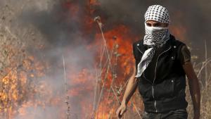 Palestinian demonstrator in Gaza (photo: Reuters/M. Salem)