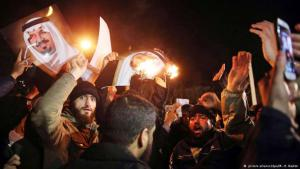 Iranian demonstrators burn portraits of the Saudi royal family in front of the Saudi embassy in Tehran
