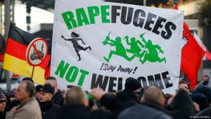 Racist banner that refutes Germany's culture of welcome