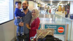 Alaa Houd meeting his family at the airport on their arrival in Germany (photo: Deutsche Welle)