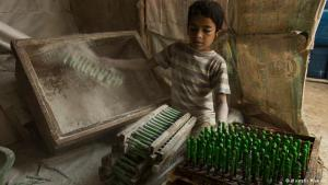 Children in a balloon factory: Extreme poverty causes families to send their children to work, often in hazardous and low-wage jobs, such as brick-chipping, construction, waste-picking or even in a balloon factory. This balloon factory in Dhaka's Kamrangi Char suburb employs many young people such as this 10 year-old child