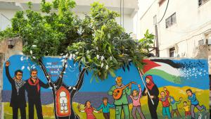 Juliano Mer Khamis of The Freedom Theatre and Safdar Hashmi of Jana Natya Manch street theatre company. Both martyred in their struggle for justice through the arts. Here they are, next to Handala, looking at the bright future of a free Palestine. Mural by Orijit Sen, in The Freedom Theatre's yard in Jenin refugee camp (source: Freedom Theatre)